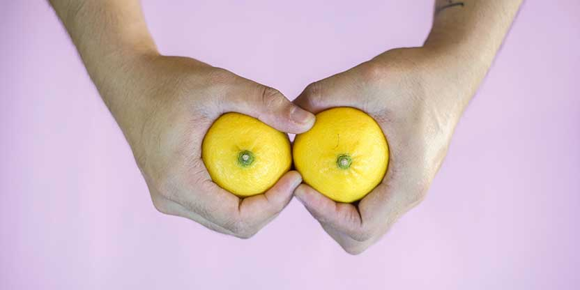 Someone holding lemons