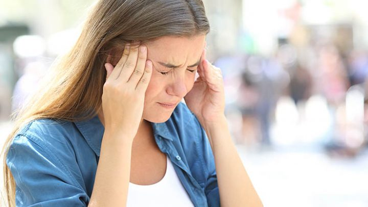 Woman suffering from migraine