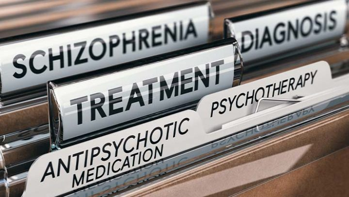 Brown files labeled with schizophrenia medical terms.