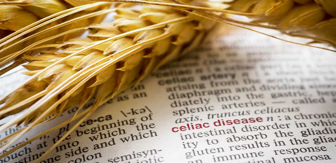 """A piece of wheat with the words """"celiac disease."""""""