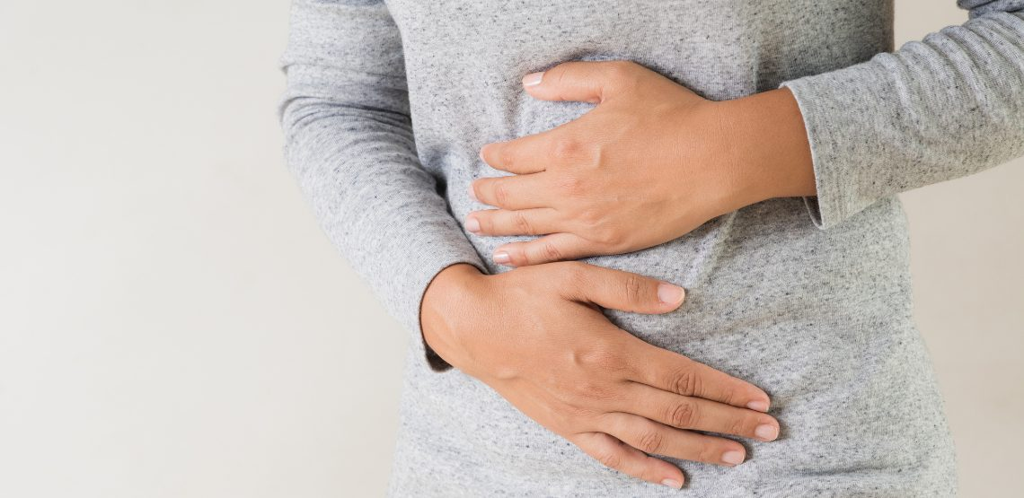 A woman holding her stomach.