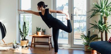 A woman doing yoga in her home.